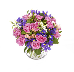 bouquet of pink roses and violet irises isolated on white