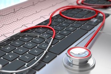 Stethoscope and ECG on laptop keyboard