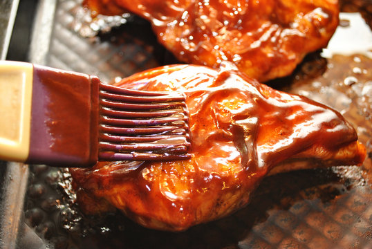 Adding BBQ Sauce on Baking Chicken