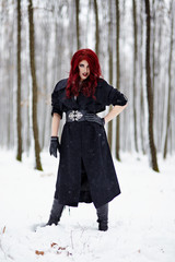 Beautiful redheaded woman in the forest