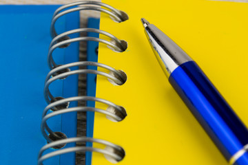 Spiral notebook and pen