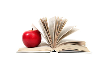 red apple on book isolated on white background