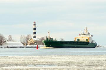 Cargo ship sailing to the port
