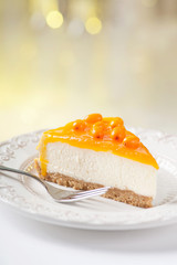 Tasty sea-buckthorn cake slice on beautiful plate