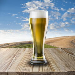 Glass of beer on wood table beautiful scene