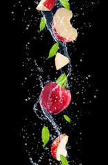 Deurstickers Opspattend water Red apples in water splash, isolated on black background