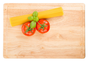 Tomatoes, basil and uncooked spaghetti