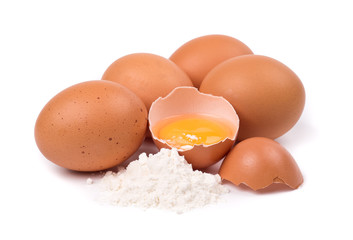 Eggs and flour isolated on white background