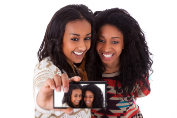 Young black african american teenage girls taking pictures with