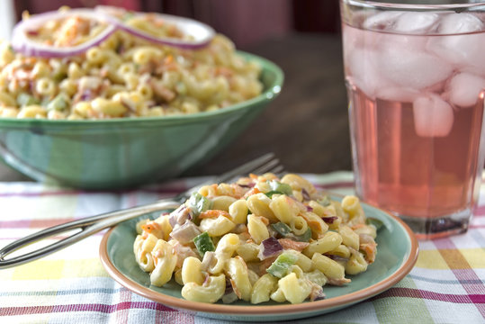 A serving of traditional macaroni salad with lemonade