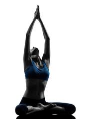 Wall Mural - woman exercising yoga meditating sitting hands joined