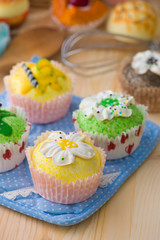 cupcakes muffins with cream fuits , breads, chocolate variety an