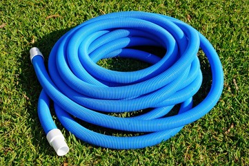 Coiled flexible pool hose © Arena Photo UK