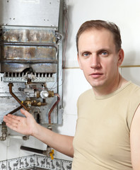 The man  thinks of repair of a gas water heater..