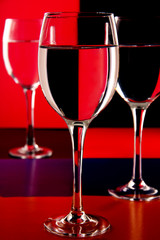 wine glasses on a colored background.