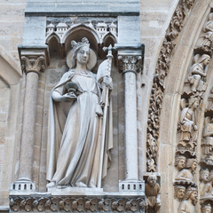 Sculptures on facade of Notre Dame (catholic cathedral) in Paris
