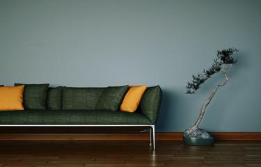 braunes Sofa vor grauer Wand