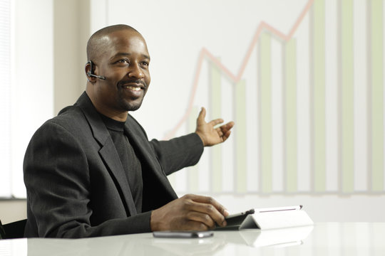 African American business man presenting profits