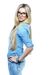 Attractive young woman posing in studio wearing sunglasses