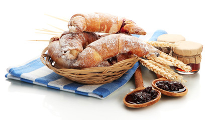Taste croissants in basket and jam isolated on white.