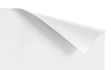 curled corners of white sheet paper