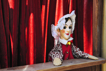 Woman puppet in red stage
