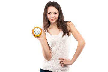 Happy girl with yellow alarm clock