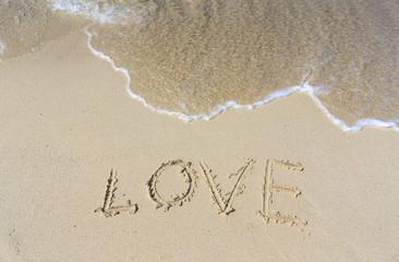 Written LOVE on sand beach