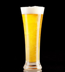 Glass of beer with black background