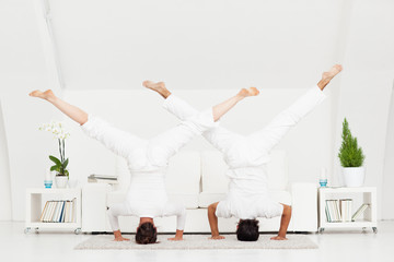 Couple Doing Headstand