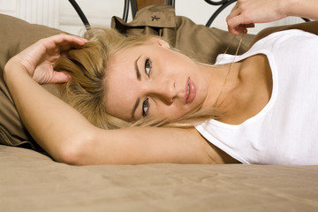 beauty blond woman in bed
