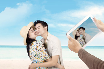 Romantic couple took picture with e-tablet