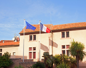 Europe and European Union flags on the background of the house a