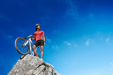 Wall Mural - confident mountain bike man celebrating
