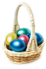 Multi-colored Easter eggs in basket with handle