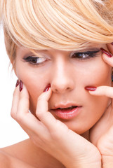 Portrait of a blonde woman with beautiful nails