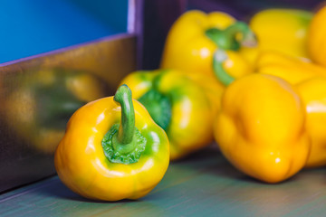 Yellow bell peppers on a conveyor belt