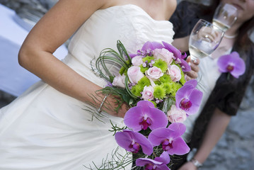 Bride holding whine glass and beautiful bridal bouquet