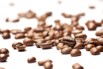 coffee beans, scattered on a white ground