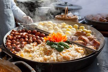 Sausages, potatoes, cabages and pork in big pan