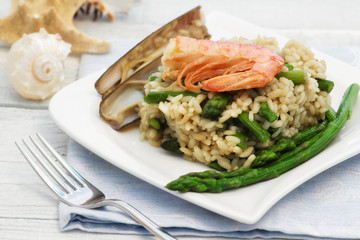 light risotto with asparagus, razor shell and prawn