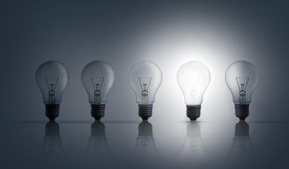 Five light bulbs in row