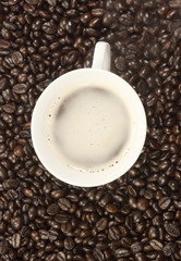 A cup of coffee and coffee beans background