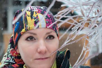 Beautiful woman in ski suit in snowy winter outdoors