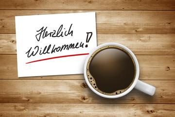 Kaffeetasse mit Herzlich Willkommen