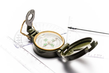 Compass and measuring instruments on white background