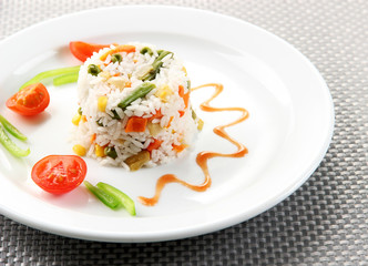 Delicious risotto with vegetables on table