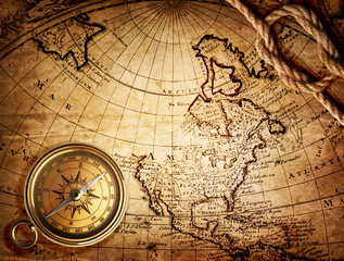 Fototapete - old compass and rope on vintage map 1746