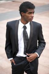 Portrait of a handsome fashion model in black suit