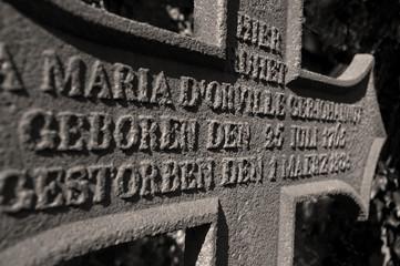 Stone cross grave inscription